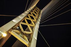 Low Angle Photography of White and Yellow Suspension Bridge at Nighttime royalty free stock images