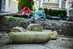 Low angle picture of grass rolls ready to be planted royalty free stock image