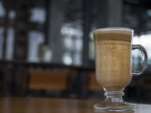 Low angle portrait of a glass of latte. It is a close up shot of a low angle portrait of a glass of latte Royalty Free Stock Photography