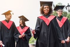 Joyful students celebrating their graduation from university royalty free stock image