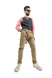 Low angle portrait of hipster standing with hands in pockets Stock Photography