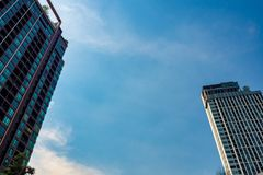 Residential building and office buildings on a cloudy blue sky background royalty free stock photography