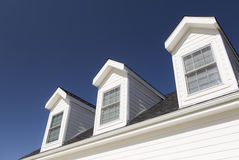 Low Angle of Roof and Windows Against Deep Blue Sky Stock Photography