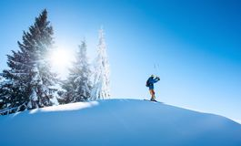 Skier resting on top of the mountain Royalty Free Stock Photography