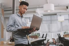 Young Asian businessman working at the office stock photo