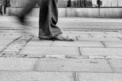 Woman walking in street. Low angle shot of female foot Royalty Free Stock Photo