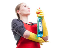 Low angle shot of female housekeeper using spray Stock Photos