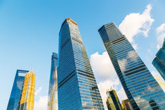 Low angle shot of modern glass city buildings with clear sky in Shanghai, China Stock Photography