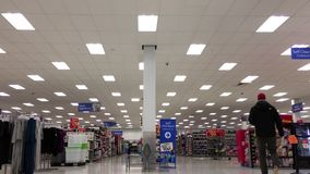 Low angle shot of people shopping. Inside Walmart store stock video