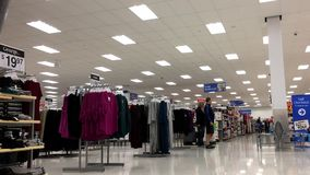 Low angle shot of people shopping. Inside Walmart store stock footage
