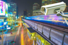 Low angle shot on security camera with sky train. In city background Royalty Free Stock Photo