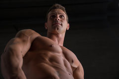 Low angle shot of shirtless male bodybuilder on Royalty Free Stock Images