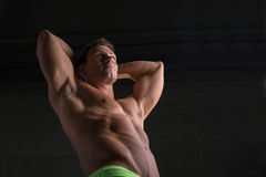 Low angle shot of shirtless male bodybuilder on Stock Photo
