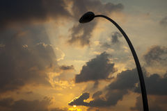 Street Lamp Silhouette & Setting Sun Stock Photo