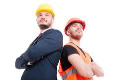Low angle shot of successful engineer and manager. Posing with crossed arms isolated on white Royalty Free Stock Photo