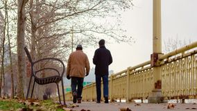 Two Men Walking Away from Camera in Pittsburgh on a Winter Day. Low angle shot of two men walking outside away from camera in downtown Pittsburgh on a cold stock video