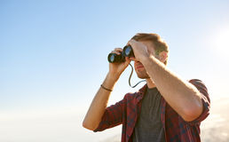 Low angle shot of a young man using binoculars Stock Photos