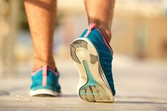 Sport shoes of young man walking. Low angle sport shoes of young man walking Stock Photography