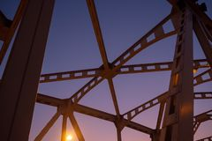 Low angle of steel bridge structure on twilight sky background royalty free stock images