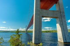 Low angle view from underneath the bridge at the high coast. Low angle summer view from underneath the tall and long suspension bridge at the high coast in royalty free stock photos