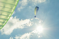 Low angle in sun light of paragliders Royalty Free Stock Photos