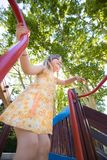 Happy girl playing in playground from low angle Royalty Free Stock Photography
