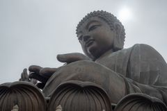 Low angle of Tian tan the great buddha in hongkong on clouds sky background stock photography