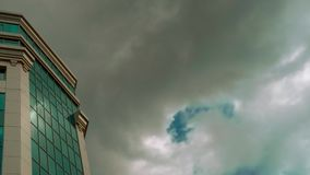 Low angle timelapse view of Skyscrapers in Frankfurt showing clouds moving overhead 4k. Low angle timelapse view of Skyscrapers in Frankfurt showing clouds stock video