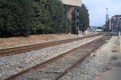 Train tracks in urban setting royalty free stock image