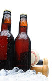 Low angle two beer bottles with baseball Stock Image
