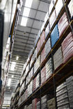 Low angle vertical view of stock in a distribution warehouse Royalty Free Stock Image