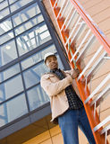 Low angle view of African construction worker Royalty Free Stock Photo