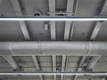 Air Conditioning Ducts and Piping with Illumination on the Ceiling. Low Angle View of Air Conditioning Ducts and Piping with Illumination stock photos