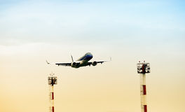Low angle view of airplane. This photograph represent a low angle view of airplane landing process stock images