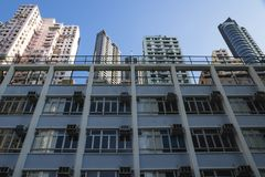 Low angle view on apartement buildings in Hong Kong, Asia. Low angle view on apartement buildings in different colors in Hong Kong, Asia Royalty Free Stock Images
