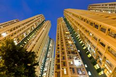 Low angle view apartment building. Asian young woman Royalty Free Stock Image