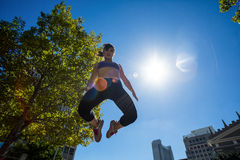 Low angle view of athletic woman jumping in the air Royalty Free Stock Image