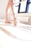 Low Angle View of Ballerina Doing Barre Exercises Royalty Free Stock Image