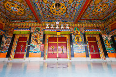 Rumtek Monastery Entrance Doors Ceiling Low H. A low angle view of the beautifully painted doors and ceiling of the entrance to Rumtek monastery, the seat of the Royalty Free Stock Image