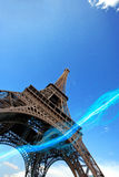 Low angle view of blue streak of lights passing under Eiffel Tower Royalty Free Stock Photos