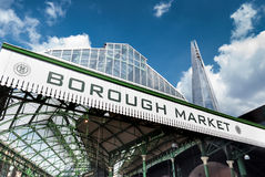 Low angle view of Borough Market and The Shard. LONDON, UK - MAY 12, 2016: Low angle view of Borough Market sign and The Shard Royalty Free Stock Photography