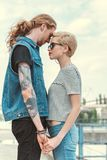 low angle view of boyfriend with tattoos and stylish girlfriend royalty free stock photo