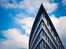 Low Angle View of Building Against Cloudy Sky Stock Photography
