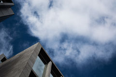 Low Angle View of Building Against Cloudy Sky Stock Images