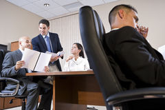 Low angle view of business meeting in boardroom Royalty Free Stock Photos