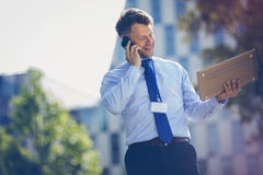 Low angle view of businessman talking on mobile phone Stock Images