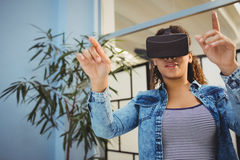 Low angle view of businesswoman enjoying augmented reality headset at office stock photos