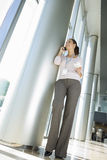 Low angle view of businesswoman talking on cell phone Royalty Free Stock Image