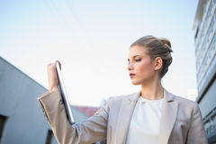Low angle view of classy businesswoman holding tablet computer Royalty Free Stock Photo