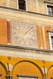 Low angle view of a clock on the wall of a building. Rome, Rome Province, Lazio, Italy Royalty Free Stock Photos